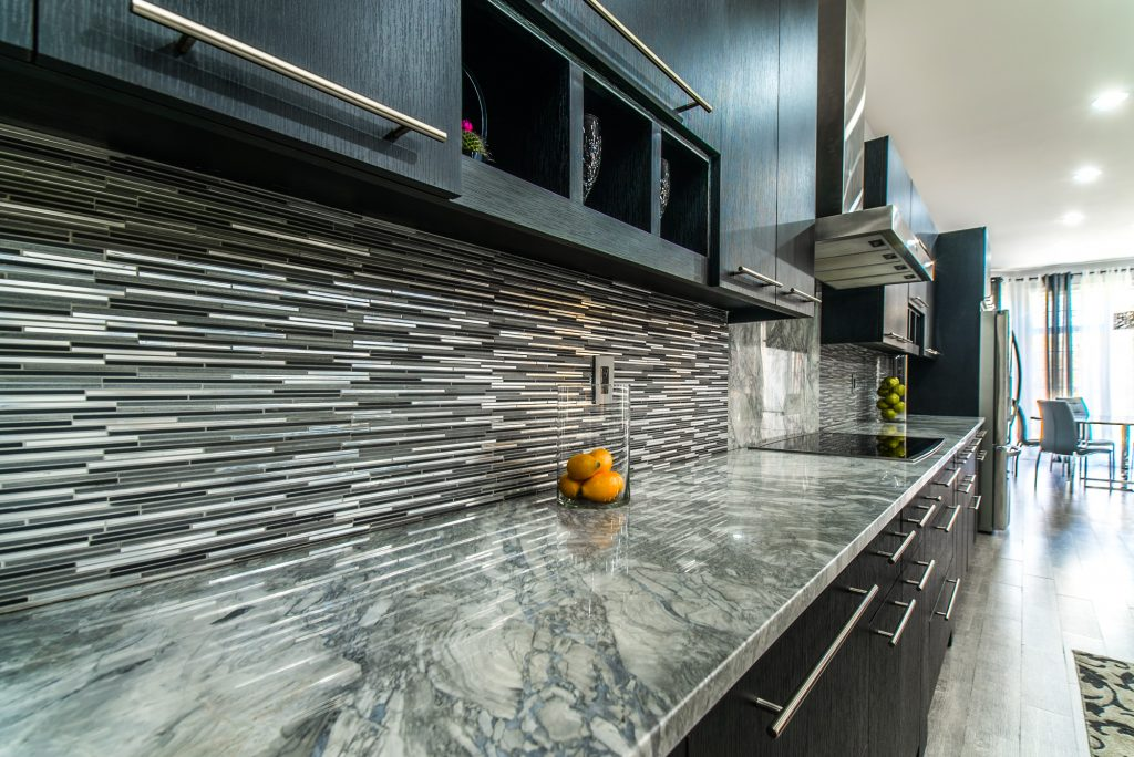 Marble kitchen counter with tile backsplash installed