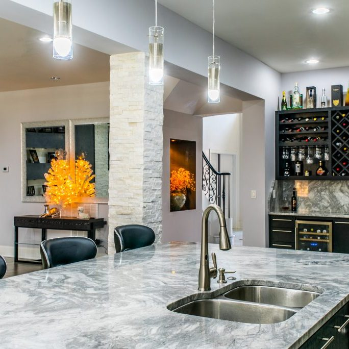 Marble kitchen island bar renovation by East Coast Granite of Charlotte