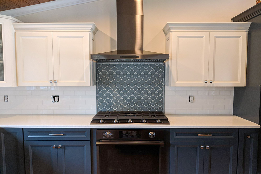 Blue Wave Tile Backsplash Paired With White 3x6 Subway