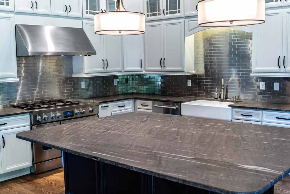 Kitchen Island Topped With Brown Silk Satin Granite