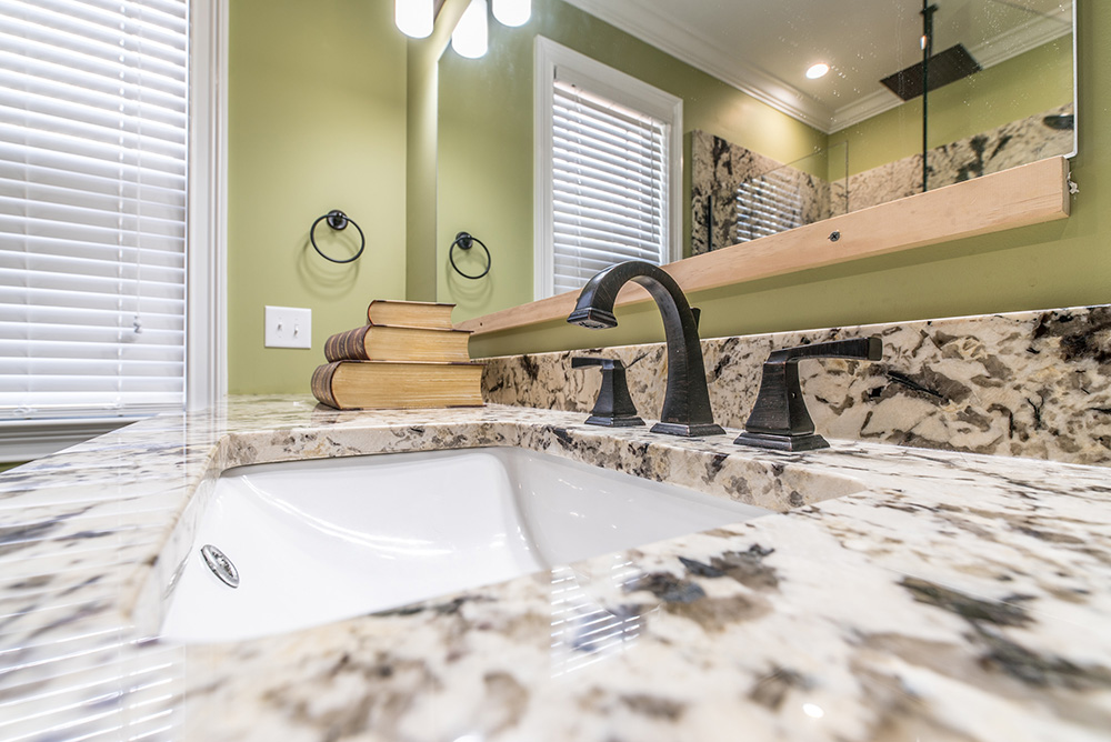 A spacious Delicatus White granite vanity with under mount sink