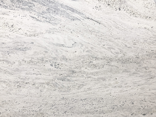 Kashmir White granite features white and gray swirls resembling sand drifts