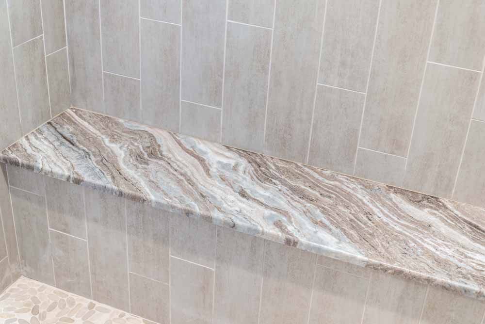 Custom Shower Bench Topped With Leathered Fantasy Brown Marble