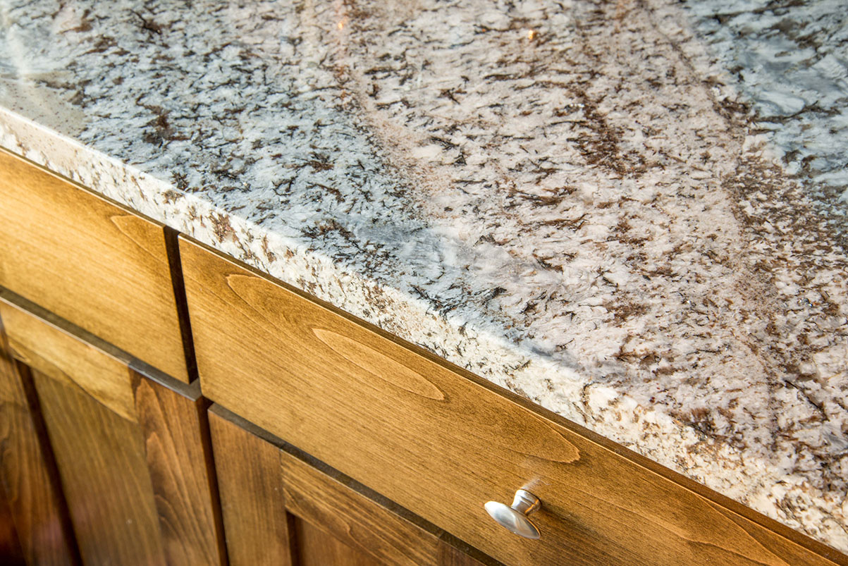 Lennco Granite kitchen countertops adding a great neutral and airy feel to this kitchen