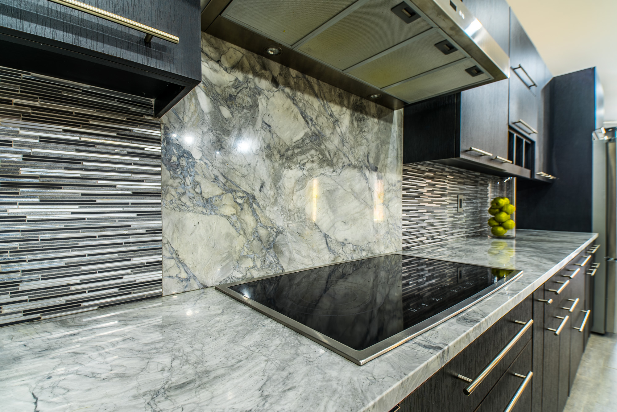 Marble countertops are a great way to tie colors in from all parts of the room