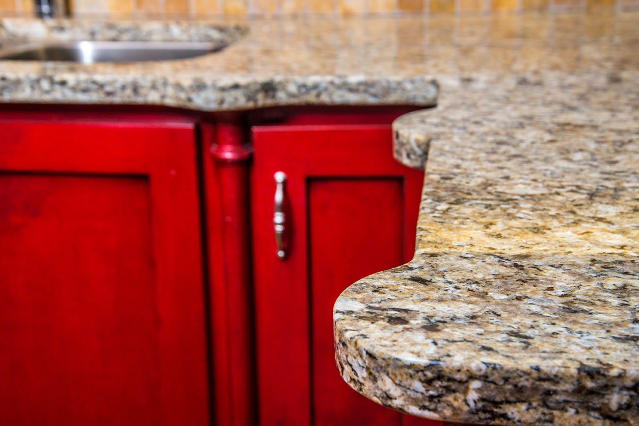 Unique scalloped decorative edges on St. Cecelia granite countertops