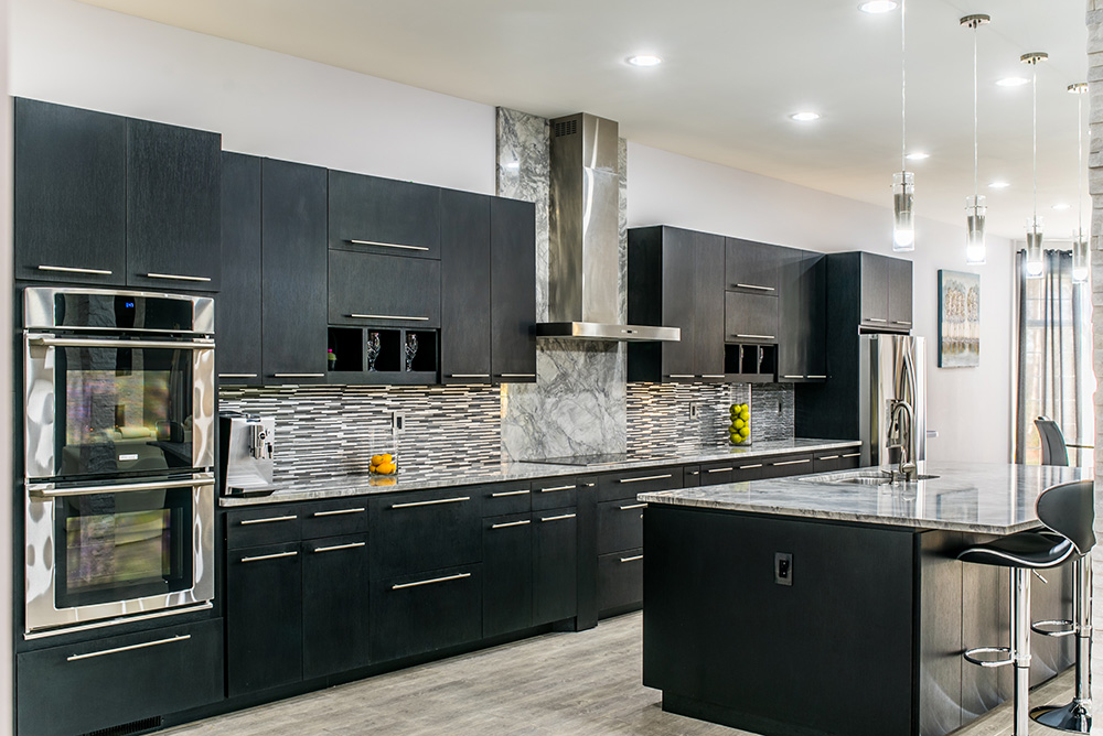 Super White marble countertops matched with dark cabinets, glass tile and stainless appliances