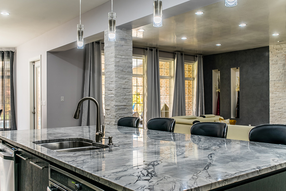 Large central kitchen island surfaced with Super White marble