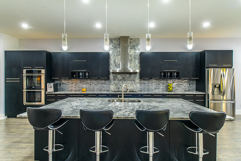 Super White Marble on a spacious kitchen island large enough for guests and a prep area