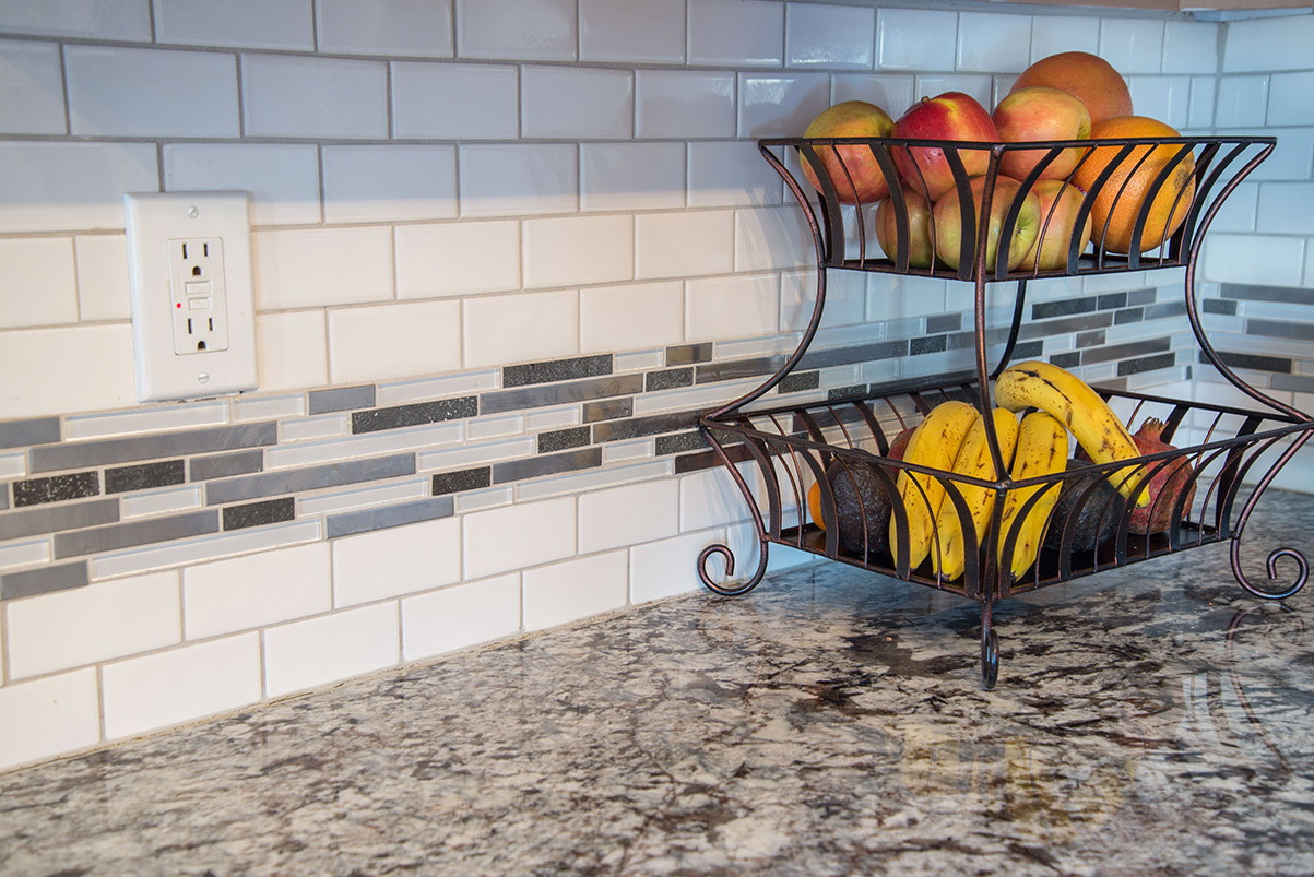 White Subway tile with Glass Tile Accent above Lennco Granite countertops